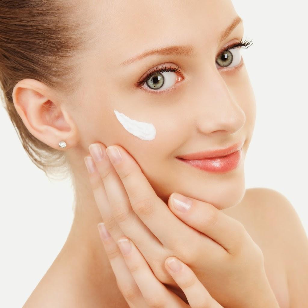 bigstock-Cute-woman-applying-cream-to-h-38782795